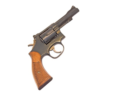 six shooter: Classic six shooter  Profile of a  38 caliber gun with wood grip  Isolated on a white background  Room for text