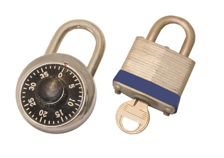 Secure choices  Closed combination lock and padlock with key side by side isolated on a white background  Stock Photo - 17046124