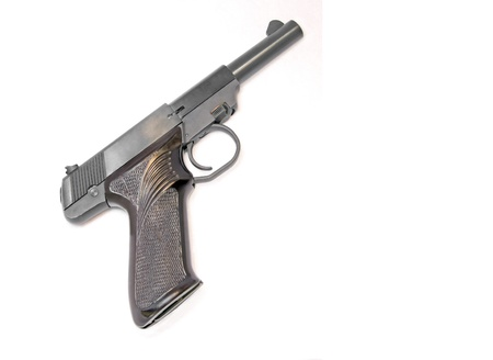automatic pistol: Small handgun  Profile of a  22 caliber gun with decorative grip  Isolated on a white background  Horizontal view