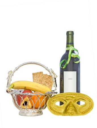 purim: A custom for the Jewish holiday of Purim is to send gift baskets of food and drink to friends, called Mishloach Manot, or Shalach Manot  Shown is a basket with fresh fruit, crackers, hamantashen, wine bottle, and costume mask