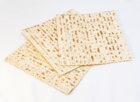 pesach: Passover food of faith, matzo  Three square matzos for the pesach seder overlapping each other isolated on white