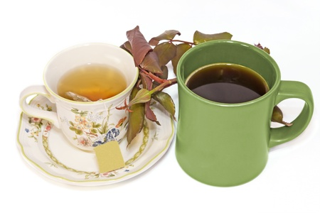 Budding romance, coffee and tea together   Floral design tea cup with saucer, green coffee mug side by side with leafy rosebud in the middle  Nice for a male, female romantic concept  Horizontal view  photo