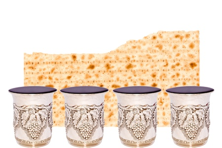 cup four: Matzah and four cups of wine for the Passover seder   Half of a broken matzah behind 4 shiny silver kiddush cups filled to the brim with red wine  Horizontal view with room for text  Isolated on a white background