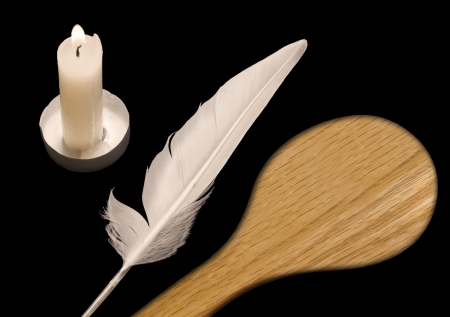 Candle, feather, and spoon   The night before Passover, a custom is to search the home for crumbs of leavened food using a candle, white feather, and wooden spoon  This religious ritual is called bedikat chametz  The three objects are isolated on black  photo