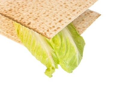 matzo: Passover seder matzo sandwich   Fresh Romaine lettuce leaves between two whole matzos for the seder ritual known as Korech  Close up profile, horizontal view  Isolated on white