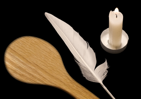 Spoon, feather, candle     The night before Passover, a custom is to search the home for crumbs of leavened food using a candle, white feather, and wooden spoon  This religious ritual is called bedikat chametz  The three objects are isolated on black