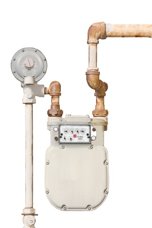 Home gas meter   Domestic natural gas meter and rusty pipes isolated on a white background  Vertical view  photo