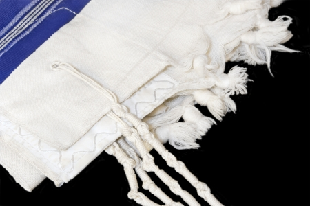sephardi: Jewish prayer shawl, tallit  White wool cloth garment with knots and fringes worn by Jewish men during prayer services  Blue stripes indicate Sephardic style and custom