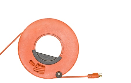 prong: Power cord extension with 3 prong plug wound on orange plastic spool, black handle   Rolled up sheathed electric cable for home or office to supply power  Isolated on a white background  Horizontal photo, room for text, copyspace