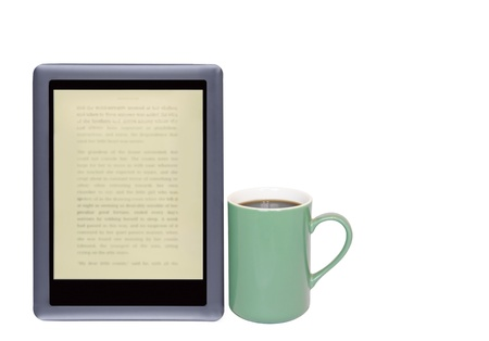 e reader: E reader and coffee cup  Need caffeine    Digital tablet, blurry words on screen  Green coffee mug with black coffee  Horizontal photo  Isolated on a white background  Room for text, copy space