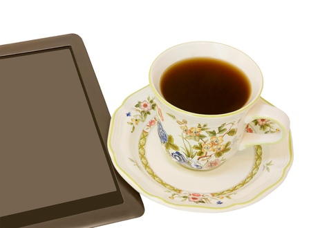 e reading: E reader and black coffee   Digital tablet with elegant ceramic coffee cup and saucer  Floral design  Horizontal photo  Isolated on a white background