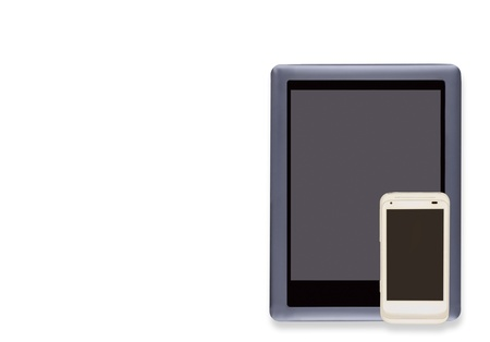 Technology gadgets to stay connected   E reader and white cell phone, blank screens, isolated on a white background  Soft drop shadow  Horizontal photo  Room for text, copy space  photo