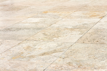 Rough textured stone tiles, exter walkway, perspective view   Large square slab patterned flooring  Horizontal photo   Stock Photo - 22613256
