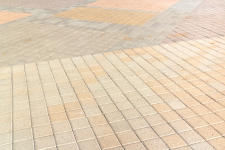 perspective grid: Multicolored paving stones perspective   Square brick grid pattern at different angles, for an urban outdoor walkway  Gray, beige, orange, colors  Horizontal view
