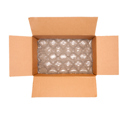 the padding:  wrap inside shipping box   Brown cardboard container, open flaps  Large puffy bubbles for package padding and protection  Horizontal, isolated on a white background