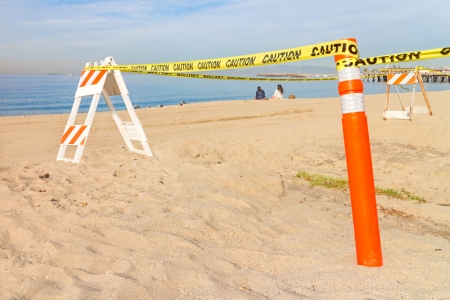 impede: Beach construction site barrier in sand    Stock Photo