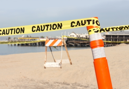 impede: Beach construction site warning in sand