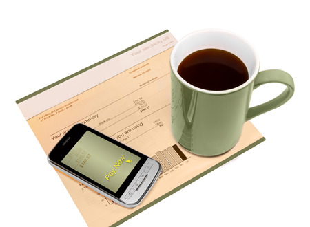 utility payments: Paying the electric bill online, quick easy mobile payment with a smart phone   Stock Photo