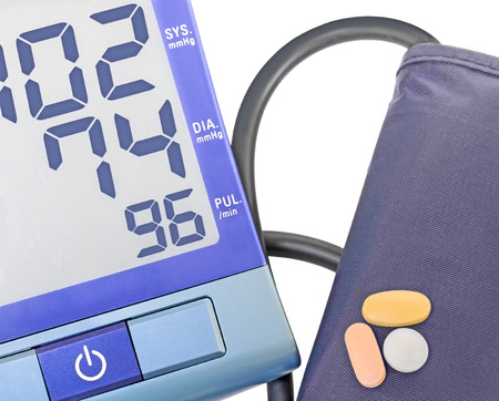 Blue digital blood pressure monitor, cuff, and pills   .Push button operation  Electronic number readout  Systolic, diastolic, pulse rate measurement  Isolated on a white  photo