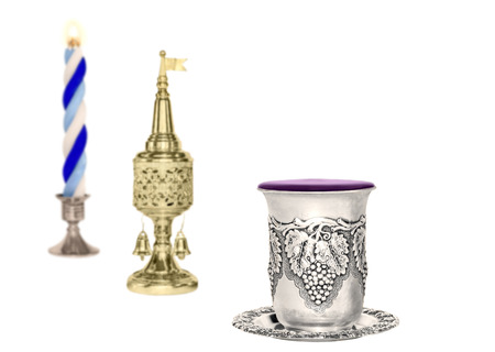 Havdalah set, selective focus on silver wine cup, isolated on white with copyspace photo