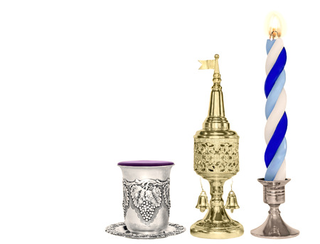 Silver wine cup, gold color spice box, braided blue and white lit candle Stock Photo - 26079049