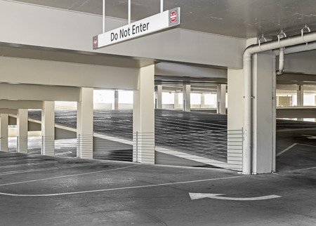 parking lot interior: Covered parking lot garage with empty parking spaces  Editorial