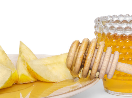 Apple slices and flowing honey, symbols of Rosh Hashana, the Jewish New Year    photo