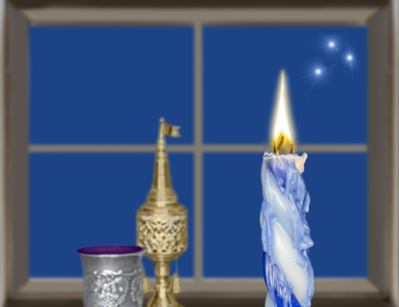 sabbath: Photo of havdalah set  Focus on braided lit wax candle  Window, stars and sky illustrated background    Jewish religious ritual objects used for conclusion of Sabbath  Stock Photo