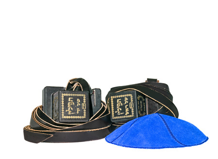 kippa: Tefillin and blue suede kippa.  Nice for prayer or bar mitzvah theme. Room for text, copy space  Isolated on a white background   Stock Photo