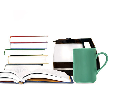 Hardcover books, coffee mug, and coffeepot isolated on white   Selective focus on green ceramic cup and open book  Blurred stack of books and glass pot in background  Staying awake for school exam or business concept  photo