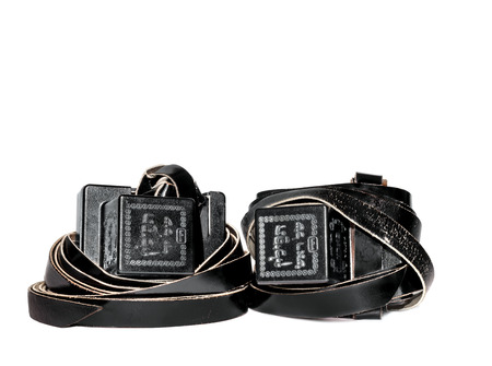 bar mitzvah: Old pair of tefillin  Worn by Jewish men during prayer  Black boxes have portions of the Torah written on parchment  Embossed with Hebrew words and decorative design  Nice for a bar mitzvah theme  Room for text, copy space  Isolated on a white background  Stock Photo