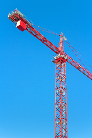 counterweight: Construction tower crane against clear blue sky   Heavy industry metal frame structure showing counterweight and counter jib.  Stock Photo