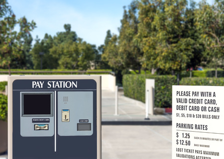 parking station: Outdoor parking lot exit pay station in suburban area