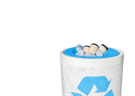 full filled: Full recycle bin filled to the top with empty plastic water bottles and paper coffee cups   Heavy rough texture stone trash can with blue recycling . Isolated on a white background with copy space. Horizontal composition. Stock Photo
