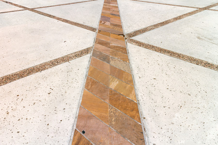 criss: Outdoor stone tile floor exterior walkway perspective view.   Criss cross design with rectangle slab and pebble flooring.