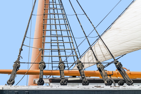 rigging: Tall ship rigging detail.   Vintage sailing ship block and tackle mast and sail