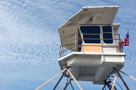 life guard stand: Blue sky with cloudscape of altocumulus clouds background. Room for copy space.