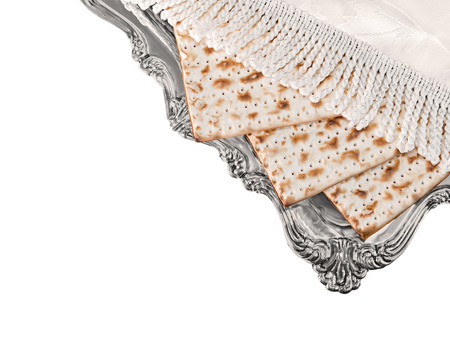 matzos: Matza on elegant silver plate covered with decorative white fringed cloth, top view   3 matzos traditional for the Passover seder isolated on white background. Room for text, copy space.