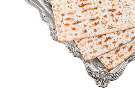 matzos: Matza on elegant shiny silver plate, top view   3 matzos traditional for the Passover seder. Isolated on white background. Room for text, copy space.