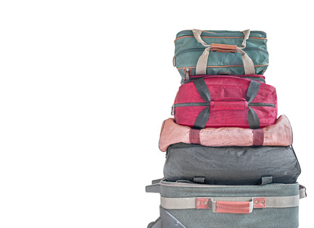 duffle: Luggage stack.   Pile of small cloth rolling suitcase and nylon duffle bags. Isolated on a white background. Copyspace. Stock Photo