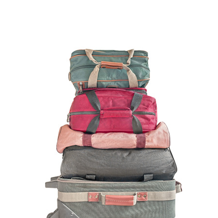 duffle: Pile of luggage.   Stack of small cloth rolling suitcase and nylon duffle bags. Square composition. Isolated on a white background. Stock Photo