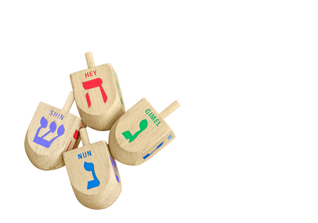 dreidels: Group of Chanukah wooden dreidels isolated on white background, top down view.  Stock Photo