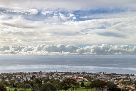 la: Cloudscape over Pacific ocean and horizon near La Jolla a suburb of San Diego, California.  Late afternoon aerial view of thick clouds over the water.