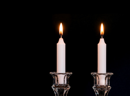 flame background: Jewish Sabbath glass candlesticks and burning candles.