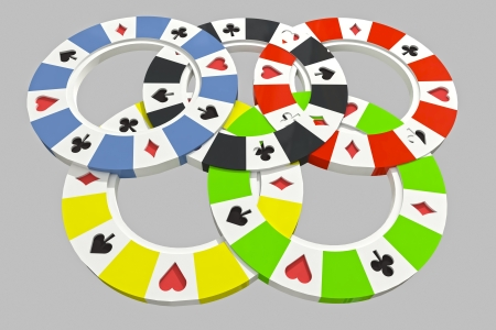 closeup focused on black, yellow, green, blue and red poker chips situated in olympic circles photo