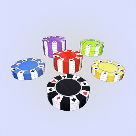 closeup focused on black, yellow, green, violet, blue and red poker chips in separate columns photo