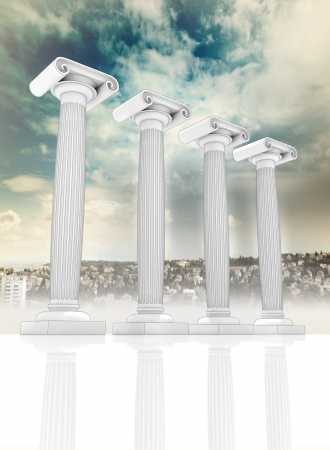 roman pillar: four column in the ancient Greek Ionian style in row on cityscape backgroung with blue cloudy sky