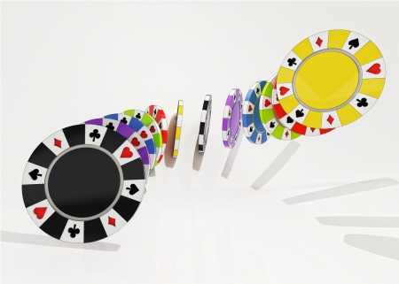 closeup focused on air three dimensional composition couple black, yellow, green, violet, blue and red poker chips isolated on light yellow background photo