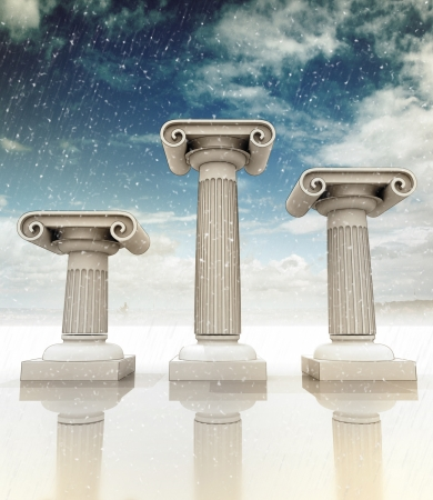 three detailed columns in the ancient Greek Ionian style as podium on blue snowy sky backgroung photo