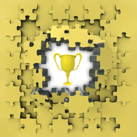 revelation: yellow puzzle jigsaw with champion cup idea revelation illustration Stock Photo